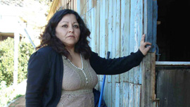Film subject Iselsa stands outside her home in Valparaiso, Chile