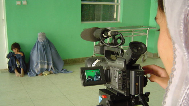 Jamila Emami filming at a clinic in Kandahar