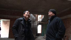 Ai Weiwei and art assistant Inserk Yang inspect the construction of a new studio in Shanghai in 2010.