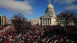 Protestors gather outside the Capitol building in Madison, WI.