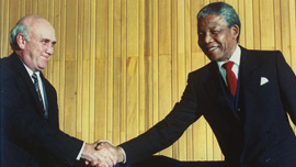 Frederik Willem De Klerk and Nelson Mandela shaking hands 