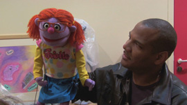 "Kevin Clash training a French Puppeteer with the puppet ""Griotte"" in Being Elmo"