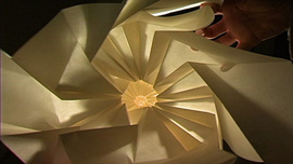 Material artist Chris K. Palmer experimenting in paper with pattern, movement and a flood light