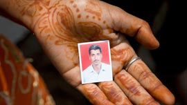 A suicide victim's photo on his son's hand