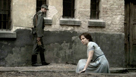 Hannah Senesh (Meri Roth) in a prison courtyard