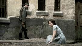 Hannah Senesh (Meri Roth) in a prison courtyard