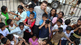 Rocky and the kids on his first trip to India
