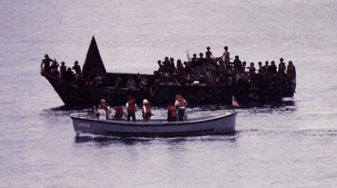 A motor whaleboat from the USS Dubuque circled the Bolinao 52