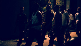 Hypnotic Brass Ensemble walking at night