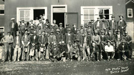 A group of Butte miners outside Al's Photo Shop, 1930s