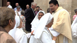 New priest Steven Gamez receives congratulations on his ordination.