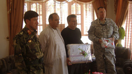 Col. Michael Shute, Gen. Fazil Ahmad Siyar, Gen. Walizidah and translator Mike Zaher at a farewell ceremony in Herat