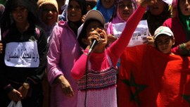 A young girl takes a lead in a demonstration about rights in Morocco.