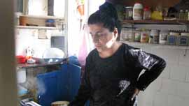 Ibrahim's wife Yusra in the kitchen