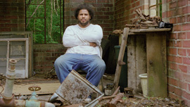 Derrick Evans in the ruins of his great grandfather's well-drilling business