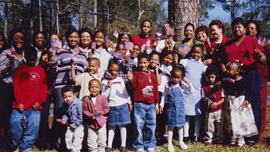 Children and adults gather for Turkey Creek's 2004 Creek Sweep – an annual clean up and outreach event.