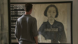 Nic Dunlop in the Tuol Sleng gallery at photo of Chan Kim Srun