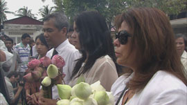 Families at a ceremony for the victims