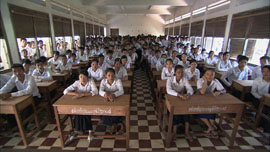 Inside a classroom filled with school children