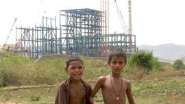 The development of India juxtaposed with children who are supposed to benefit.