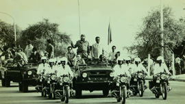 Motorcade with President Agostinho Neto and Fidel Castro during Fidel's first visit to Angola