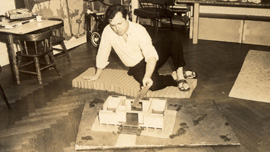 Doc with a model of a paper house for the poor, which he invented, designed, and built, c. 1962, NYC