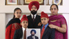Rana Singh Sodhi with his wife Sukhbir and children who hold a photo of Balbir Singh Sodhi