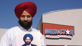 Rana Singh Sodhi stands in front of the gas station where his brother, Balbir Singh Sodhi was slain