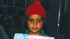 Rana's son Satpreet Sodhi holds an American Flag