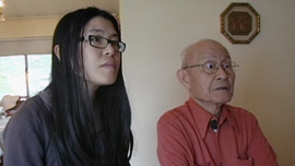 Paul Loong and Theresa Loong watching rare archival footage of prisoners-of-war in Japan