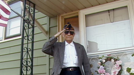 Paul Loong salutes prior to the Memorial Day Parade in Clark, NJ