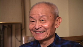 Paul Loong being interviewed during the film