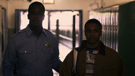 Still from film's reenactment of Darius Monroe being brought to face authorities.