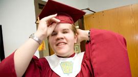 Meagan dons her graduation cap