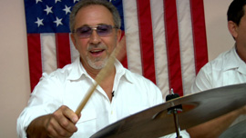 Emilio Estefan, music producer, jamming with the band at a rehearsal