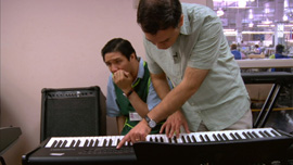 Javier gives rehearses at the keyboards with Godwin Lee.