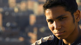 Adham, 17 years old, one of teenage boys featured in Garbage Dreams