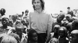 Bob Geldof with refugees from Sudan and Chad