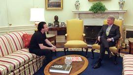 Bono meets with President Bill Clinton in the White House.