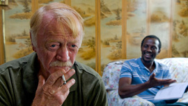 William (Red West), an elderly Caucasian man who plans to commit suicide, and Solo at a motel