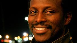 Solo (Souléymane Sy Savané), a Senegalese taxi driver in Winston-Salem, North Carolina
