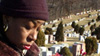 Frances Davis visiting the graves of her three sons killed by gun violence