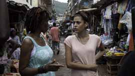 IRC Women's Protection and Empowerment Coordinator Amie Kandeh with Eva Mendes in Sierra Leone