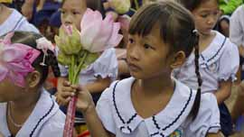 A girl holds flowers during Room to Read's 10 millionth book ceremony in Vietnam.