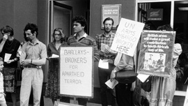 Anti-apartheid demonstrators protest Barclays Bank's involvement in South Africa. United Kingdom, 1980's