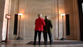 Herb and Dorothy at the National Gallery of Art in Washington, DC, viewing the benefactors list
