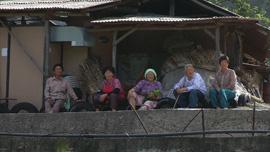 Old ladies wait for Uncle Joe's truck.