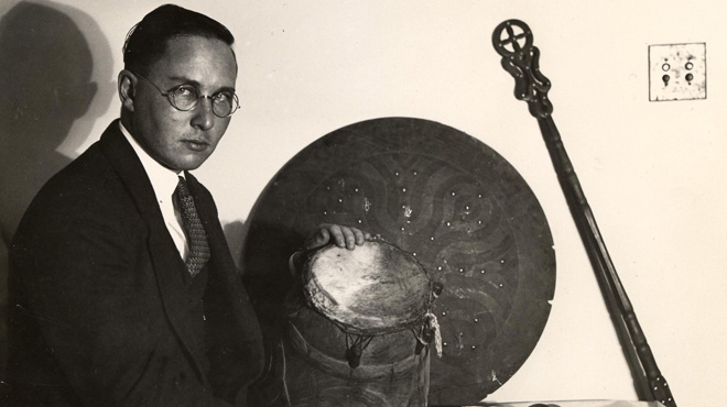 Melville J. Herskovits with various African objects