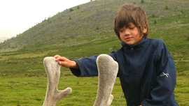 Rowan Isaacson on a reindeer in Mongolia