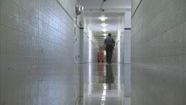 Mike Carpenter, chief of security at Lexington Prison, walks down the hallway on one of his shifts.